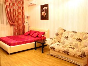 """Кровать или кровати в номере Апартаменты """"Галерея. Люкс 1-комнатный"""""""