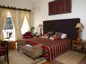 A bed or beds in a room at House of Waine