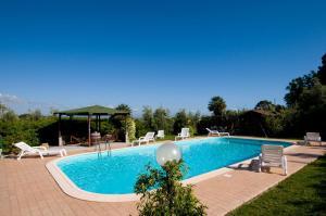 The swimming pool at or near Agriturismo De Santis