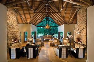 A restaurant or other place to eat at Lion Sands - Tinga Lodge
