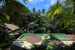 A view of the pool at The Purist Villas & Spa Ubud or nearby