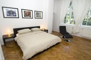 Кровать или кровати в номере Galeria Rooms