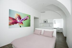 A bed or beds in a room at Galeria River