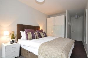 A bed or beds in a room at Your Base Dublin - Grand Canal Square