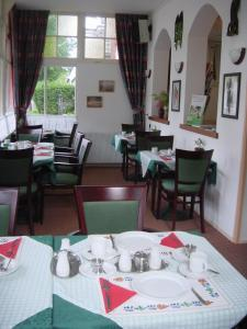 A restaurant or other place to eat at Pension Westerburen