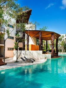The swimming pool at or near Private pool Access 2BR condo in the best location in Tulum by Happy Address