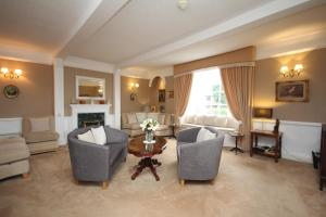 A seating area at Alcombe House Hotel