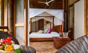 A bed or beds in a room at La Selva Amazon Ecolodge & Spa