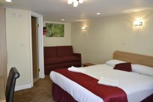 A bed or beds in a room at Cranbrook Hotel