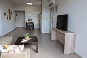 A television and/or entertainment center at Keshet Eilon - Suites and Villas