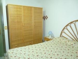 A bed or beds in a room at Attico Bellavista
