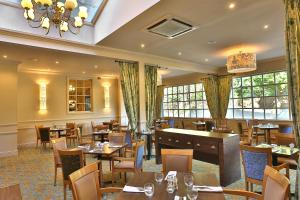 A restaurant or other place to eat at Reigate Manor Hotel