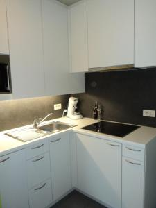 A kitchen or kitchenette at For Ever