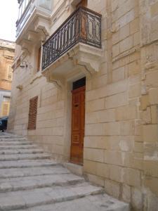 The facade or entrance of D-House