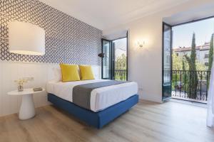 Cama o camas de una habitación en Home Club Santa Ana I
