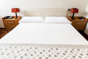 Letto o letti in una camera di Santa Caterina