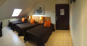 Un ou plusieurs lits dans un hébergement de l'établissement Hotel Pax