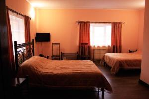 Кровать или кровати в номере Гостевой Двор