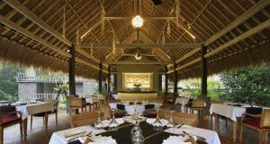 A restaurant or other place to eat at The Kayon Resort by Pramana