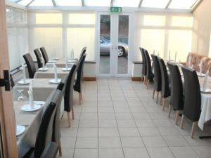 A restaurant or other place to eat at Heritage Hotel