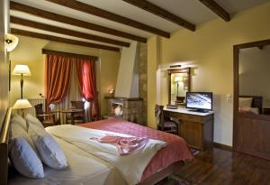 Ένα ή περισσότερα κρεβάτια σε δωμάτιο στο Alpen House Hotel & Suites