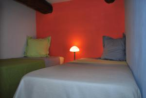 A bed or beds in a room at Bed and Breakfast Jardin de Marie