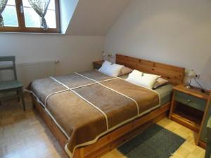 A bed or beds in a room at Farm Stay Dolinar Krainer
