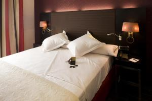 A bed or beds in a room at Hotel Boutique Gareus