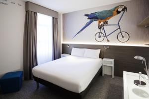 A bed or beds in a room at ibis Styles London Kensington