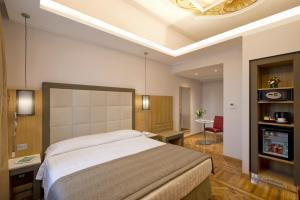 Un ou plusieurs lits dans un hébergement de l'établissement Hotel Giolli Nazionale