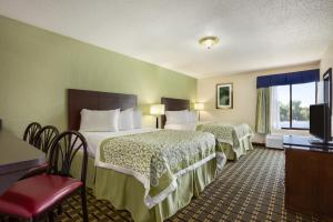 A bed or beds in a room at Days Inn by Wyndham Jasper