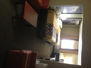 A bed or beds in a room at Super 8 by Wyndham Olney