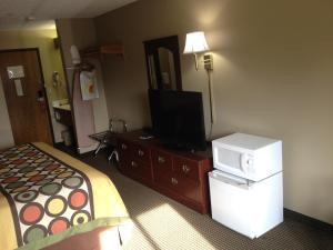 A television and/or entertainment center at Super 8 by Wyndham Olney