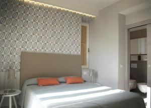 A bed or beds in a room at Ca' D'Andrean