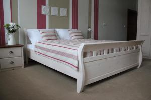 Postelja oz. postelje v sobi nastanitve Hotel Panský dům
