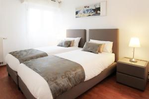 A bed or beds in a room at City Break Picquecailloux