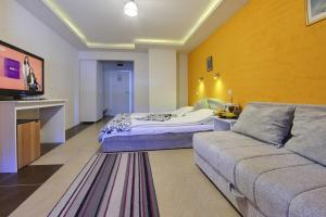 A bed or beds in a room at Vila Etna