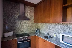 A kitchen or kitchenette at Sítio da Assumada