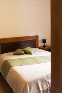 A bed or beds in a room at Sítio da Assumada