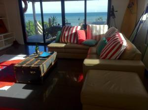 A seating area at Award Winning Beach Front Retreat
