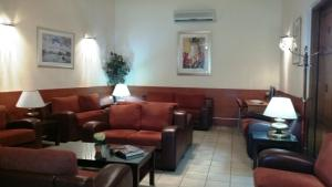 A restaurant or other place to eat at Aristoteles Hotel
