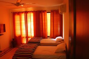 A bed or beds in a room at Madpackers Delhi