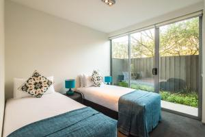 A bed or beds in a room at Orange Serviced Apartment