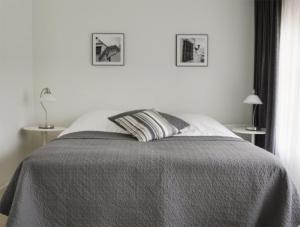 A bed or beds in a room at Hotel-Eetcafé d'Olde Heerd