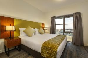 A bed or beds in a room at Quest Melbourne Airport