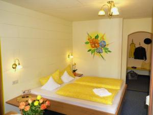 Ein Bett oder Betten in einem Zimmer der Unterkunft Haus Hoher Sattel