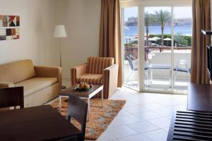 A seating area at Naama Bay Promenade Resort Managed By Accor