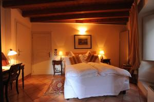 A bed or beds in a room at Albergo Orologio