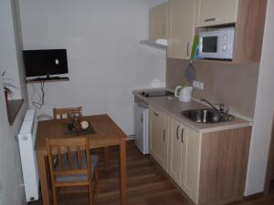 A kitchen or kitchenette at Houda Bouda - Penzion & Apartmány