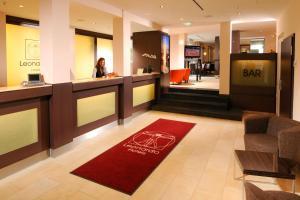 The lobby or reception area at Leonardo Hotel München City Center